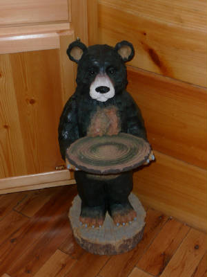 Our Bear Paws Cabin would not be complete without our welcome bear to